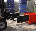 Fork clamp with slip on pads picking up bins