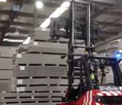 Multi fork positioner handling pallets and wide building materials