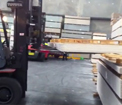 Multi pallet handler used as a wide opening sideshift fork positioner handling wide building materials and pallets