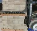 Block clamp picking up layers of blocks