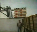 Rotating clamp with load push de-palletising bags