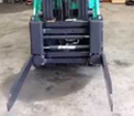 Turning fork clamp with forks turned for handling bales example