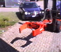Hydraulic rotating drum / wheelie bin handler example