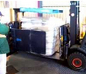 Slip sheet handler / push pull loading bags of produce into container