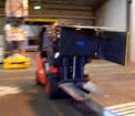 Rotating clamp with load push de-palletising bags – Load Inverter